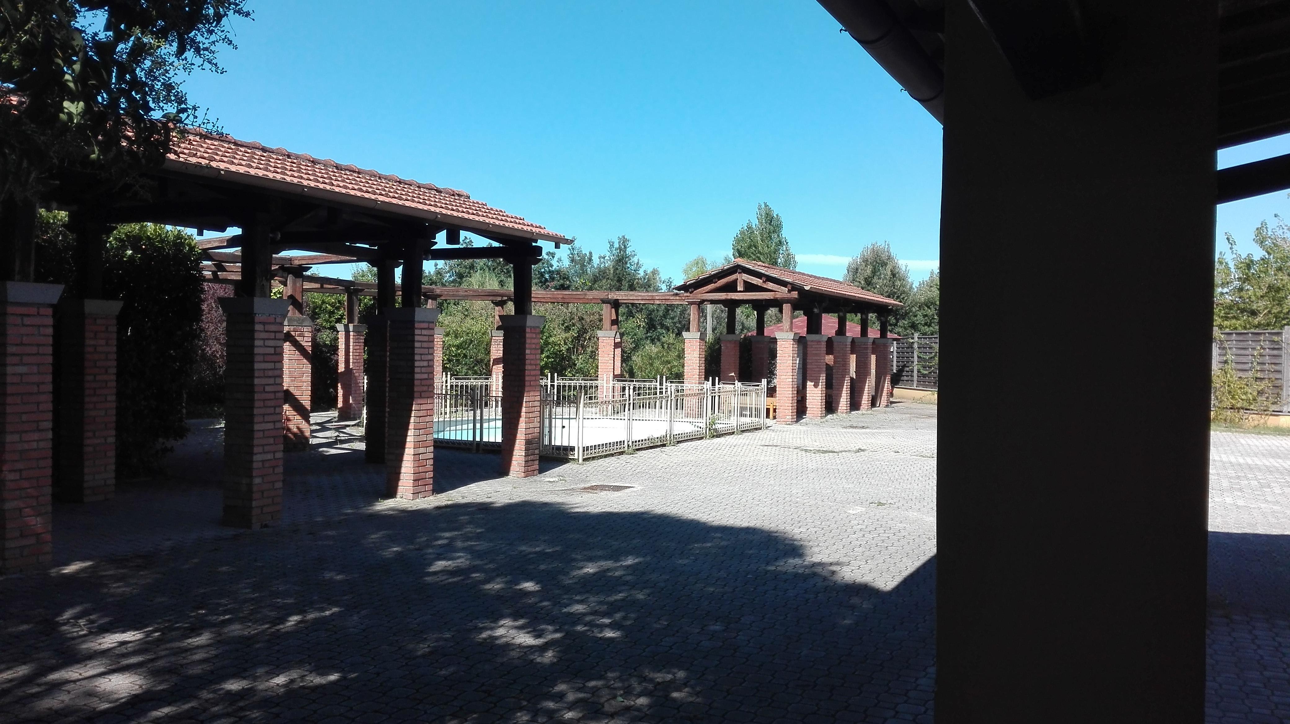 Portico e fontana nel cortile della Casa del Giardinaggio